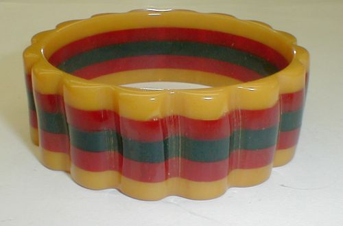 Laminated scalloped Bakelite multi color bangle. Rare