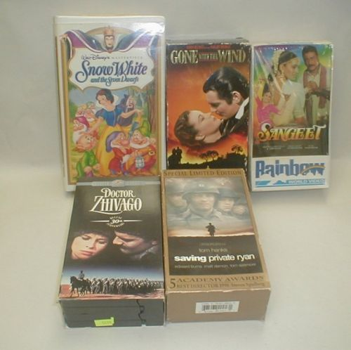 Five VHS movies and sets