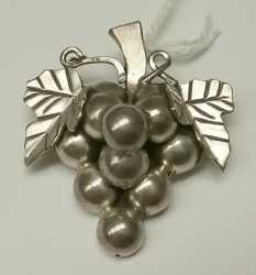 find items like this Sterling pin in the form of a Grape bunch in our Jewelry category